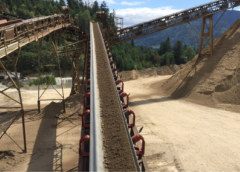 Bottom deck through material feeds the Issaquah Pit's washing plant.