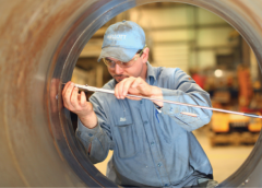 A Mellott Company crusher repair technician uses a micrometer to ensure the tolerances in a jaw crusher bearing seat.